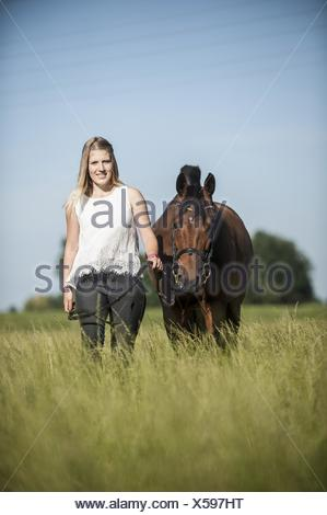 woman and German Riding Pony - Stock Photo