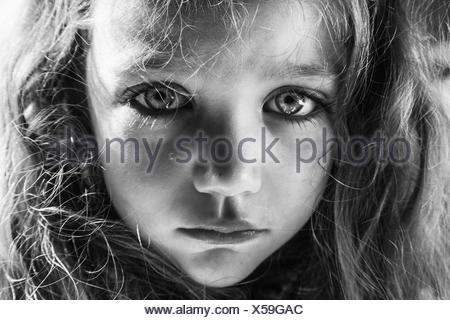 Girl with a tear running down her face - Stock Photo
