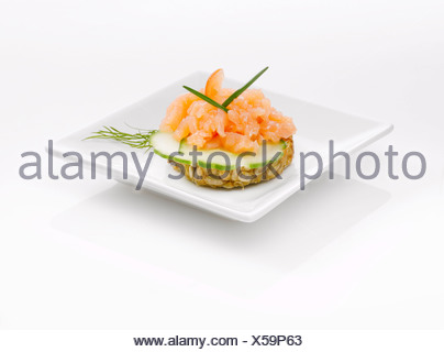 Sandwich with salmon tatar and cucumber slices - Stock Photo