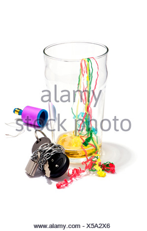 An empty pint of beer, streamers and a car key chained and padlocked