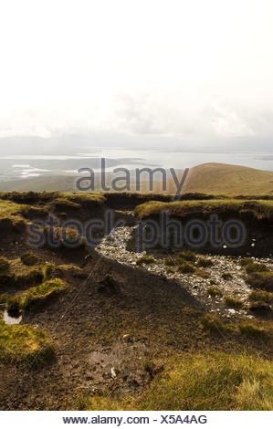 Republic of Ireland, County Mayo, Achill Island, turf banks - Stock Photo