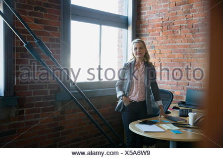 Portrait confident businesswoman in office - Stock Photo