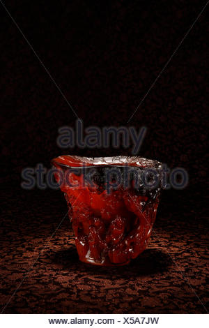 Rhino horn cup carved figures - Stock Photo