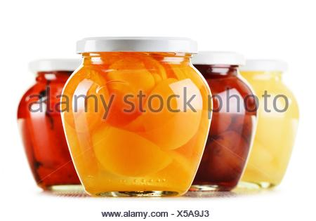 Jars with fruity compotes isolated on white background. Preserved fruits. - Stock Photo