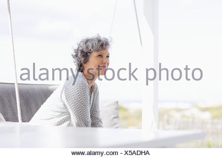 Woman sitting on a swing and day dreaming