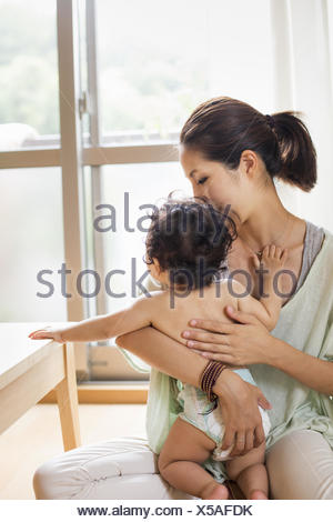 Mother holding her baby boy. - Stock Photo