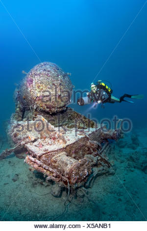 Scuba diver at the remains of a Stanier 8F locomotive, shipwreck of the SS Thistlegorm, Red Sea, Shaab Ali, Sinai Peninsula - Stock Photo