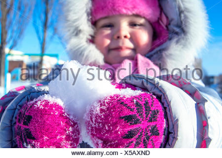 Close-Up Of Child Holding Snow - Stock Photo