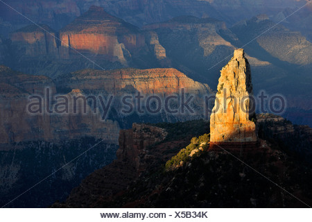 View from Point Imperial towards the last light on Mount Hayden at sunset, Grand Canyon National Park, North Rim, Arizona - Stock Photo