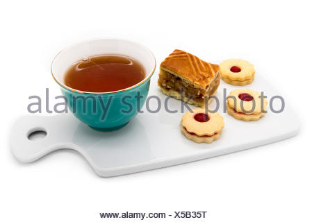 Cup of tea, a piece of apple pie and cookies with jam. On a white background. - Stock Photo