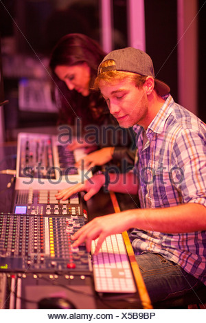 Young man and woman in college recording studio - Stock Photo