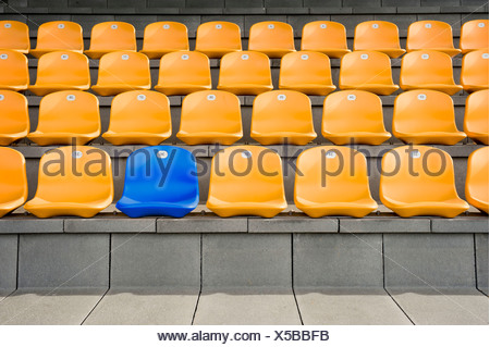 Germany, Bavaria, Empty stadium seats - Stock Photo