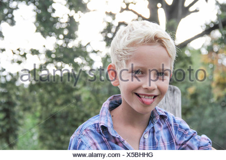 Boy with his tongue sticking out - Stock Photo