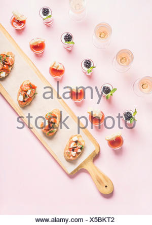 Catering, banquet, party food concept. Snacks, brushettas, gazpacho shots, desserts with berries on corporate event, christmas, birthday, wedding cele - Stock Photo