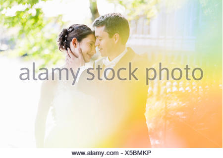 Romantic newlywed mid adult couple in park - Stock Photo