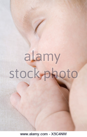 A sleeping baby, close-up - Stock Photo