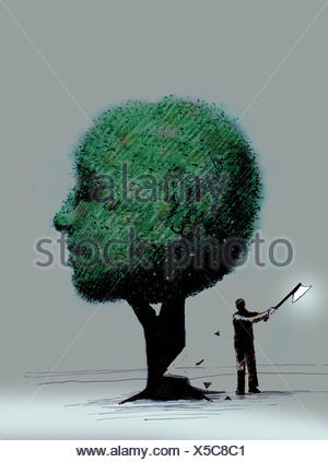 Man chopping down anthropomorphic face tree - Stock Photo