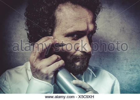 Clean, businessman with a spray, cleaning, man in white shirt with funny expressions - Stock Photo
