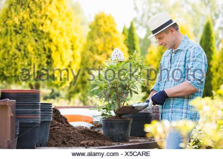 Man planting pot at garden - Stock Photo