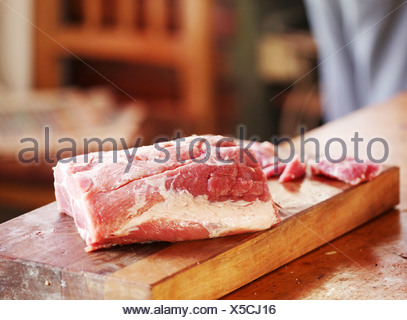 Raw pork on cutting board - Stock Photo