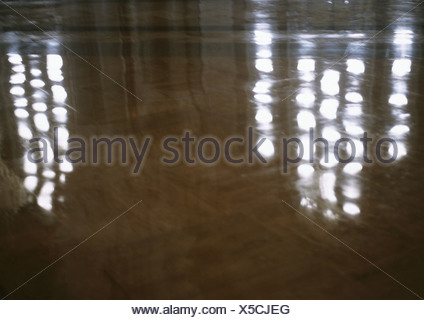 Lights reflected on marble floor - Stock Photo