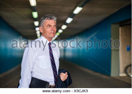 Senior businessman in a tunnel - Stock Photo