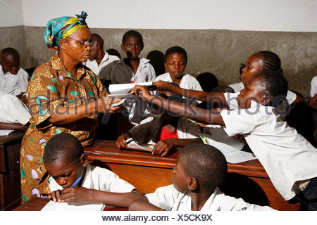 Teacher and school children in school uniform during class, Kinshasa, Congo - Stock Photo