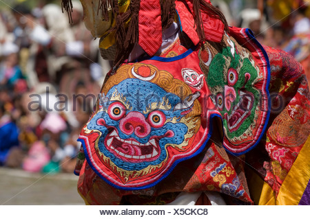 Close up of a traditional dress at religious festivity with male visitors and dances, Paro Tsechu, Bhutan, Asia - Stock Photo