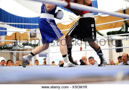 Traditional boxing match in a beer tent at the Volksfest festival in Geretsried, Bavaria - Stock Photo