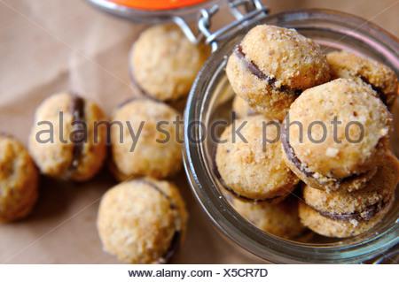 Filled hazelnut cookies (Baci) - Stock Photo