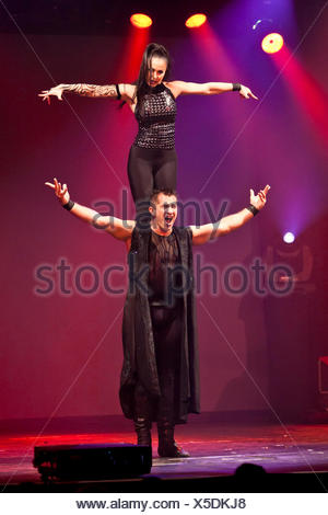 Artistic performances accompanying rock songs from the Duo Iouvilov, live, Das Zelt - Rock Circus, Lucerne, Switzerland, Europe - Stock Photo
