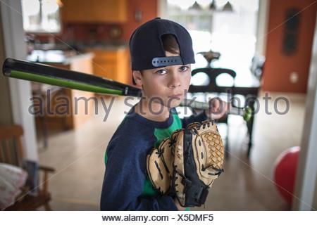 Portrait of boy baseball player with attitude - Stock Photo