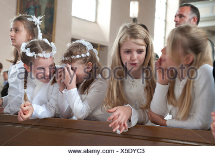 Heitersheim, Germany, Communion children at Corpus Christi in the former Maltese Castle - Stock Photo