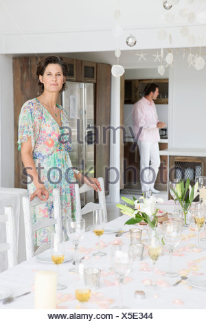 Woman arranging a table for a party - Stock Photo