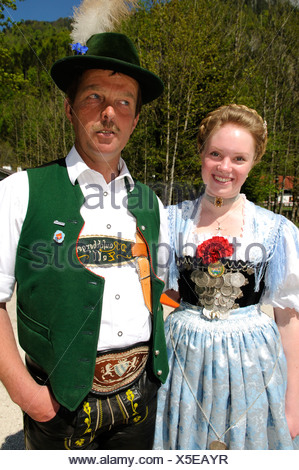 Couple wearing traditional clothes during a folk festival in Ruhpolding, Chiemgau, Bavaria, Germany, Europe - Stock Photo