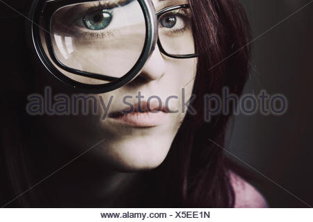 Woman Looking Through Magnifying Glass - Stock Photo