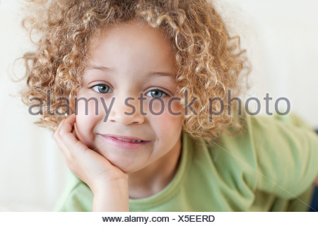 Close up of a cute boy lying on a sofa - Stock Photo