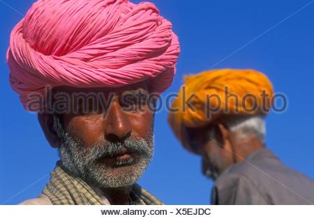 Portrait of an Indian man, Rajasthani wearing a pink turban, Pushkar, Rajasthan, India, Asia - Stock Photo