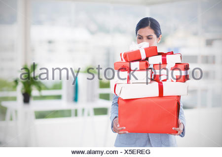 Composite image of fired businesswoman holding box of belongings - Stock Photo