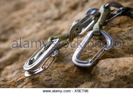 Carabineers used in rock climbing - Stock Photo