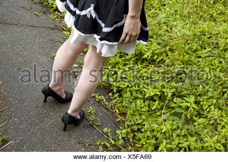 Close-up of a young woman wearing high heel shoes. - Stock Photo