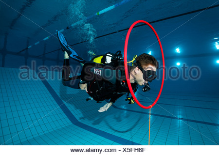 Dive training, scuba diver in a swimming pool, Nuremberg, Bavaria, Germany - Stock Photo