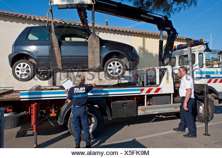 An illegally parked car being towed away, the port of St Tropez, Var, Cote d'Azur, Southern France, France, Europe - Stock Photo