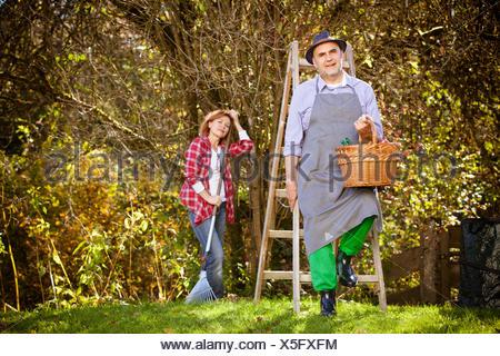 Family picking apples, Munich, Bavaria, Germany - Stock Photo