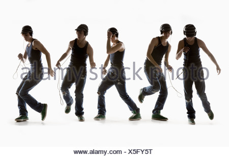 Composite Image Of A Boy Dancing With Headphones; Edmonton, Alberta, Canada - Stock Photo