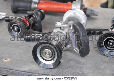 Fire fighters equipment hoses ready for use - Stock Photo