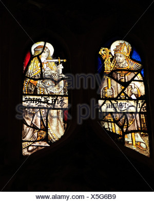 Medieval stained glass, St. Erasmus, Bishop of Formia, St. Agnes with dagger at her throat, holding a lamb, Sandringham Parish - Stock Photo