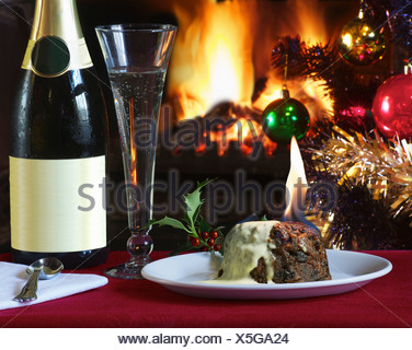Plate of flaming Christmas pudding - Stock Photo