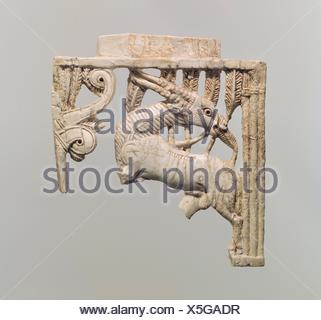 Openwork furniture plaque with a grazing oryx in a forest of fronds. Period: Neo-Assyrian; Date: ca. 9th-8th century B.C; Geography: Mesopotamia, - Stock Photo