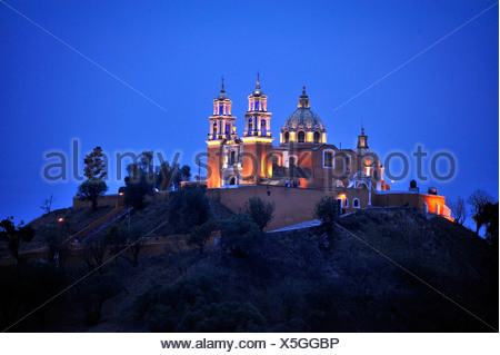 Church of Iglesia Nuestra Senora de los Remedios on the ruins of the pre-Hispanic Pyramid of Cholula at night, , Mexico - Stock Photo